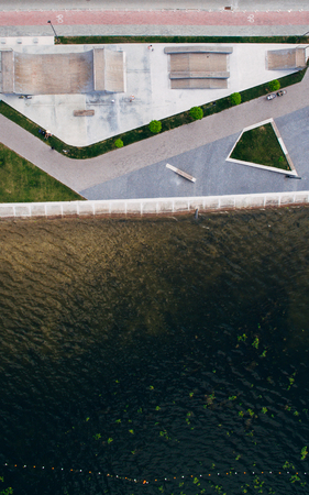 Aerial view from above on the skate park near the lake. Health zone. Stock fotó