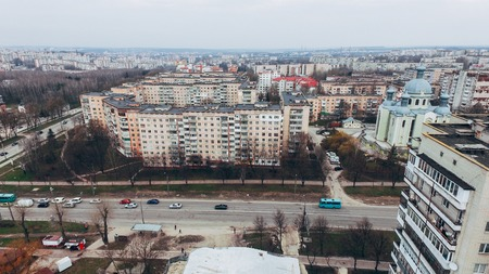 Small town with a birds-eye view in early spring, park and church. Stock fotó