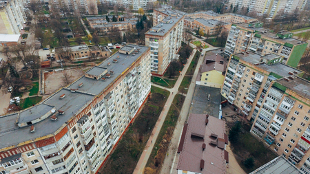 drone flies over the roofs of multi-storey houses, squares and streets. aerial view