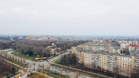 Beautiful small town with a birds-eye view in early spring, park and church. aerial view