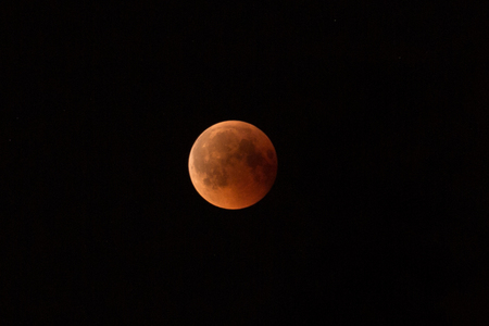 July 27, 2018 is the longest lunar eclipse of the century. The moon is painted red-brown because of the shadow of the Earth through which it passes. Stock fotó