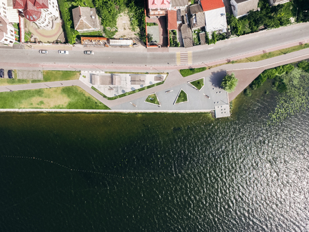 Aerial view from above to the embankment, beach and skate park near the lake. Health zone.