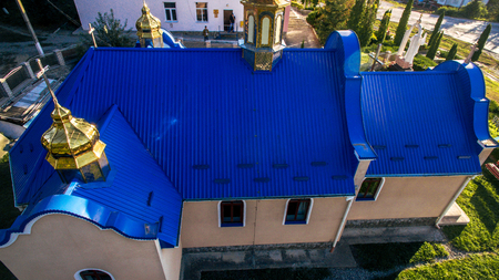Aerial view of Blue tile and a beautiful arched window on the new church