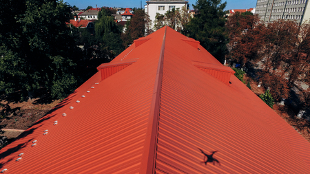 Aerial view of the wide red tiled roof.