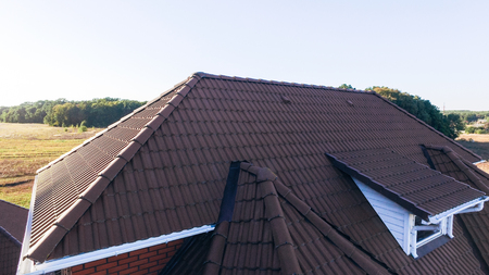 Aerial view of the wide brown tiled roof.