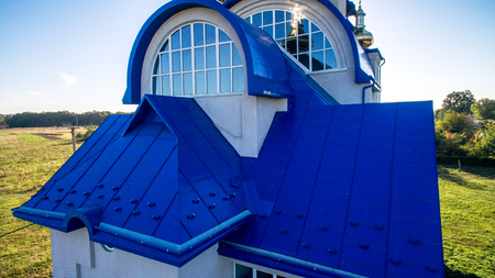 Blue tile and a beautiful arched window on the new church
