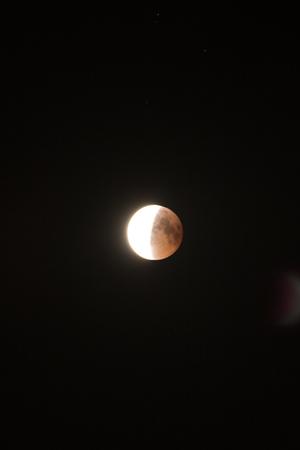 Lunar eclipse in the black night sky Banco de Imagens