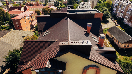 Aerial view of the red roof of the new original house built on an individual project