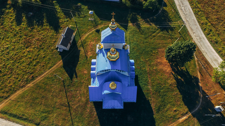 Top view of the blue roof of a new church in a small village Stock fotó