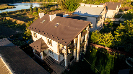 New beautiful modern house by the lake. My dream house.. Aerial view Banco de Imagens