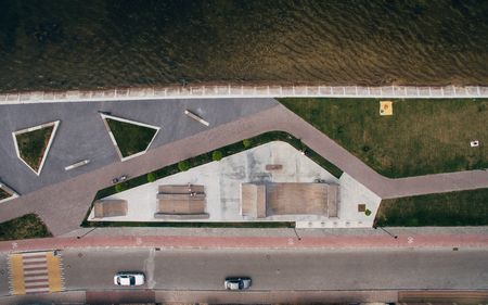 Lake and recreation area, the beach before a thunderstorm in the summer evening aerial view