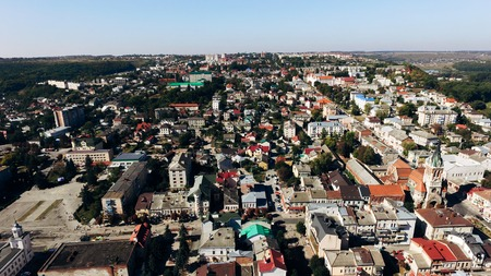 Top view of the old town and new houses with colorful bright roofs. Air view