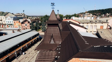 Aerial view of the new brown tiled roof with a weather vane. Banco de Imagens