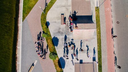 Young people dancing, singing and playing sports on the city s waterfront, aerial shooting from drone. Surrealism