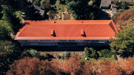 Aerial view of the house with a red tile roof