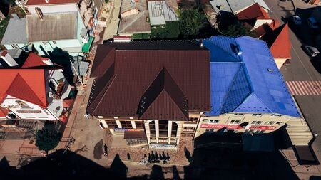 Aerial view of the bright multi-colored tiled roofs of new modern houses. Stock fotó