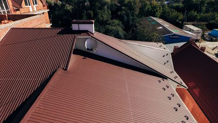 Aerial view of a new big brown roof from modern high-quality material