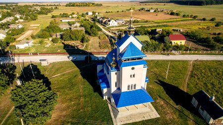 Aerial view of a new modern church with a blue tiled roof. Stock fotó