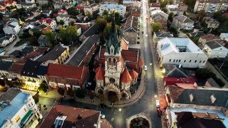 Aerial view of a new modern church in the center of a small town on a summer day. Ukraine