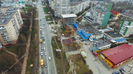 Aerial view of small town street, highway, early spring park Stock fotó