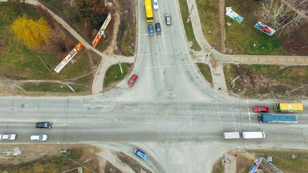 Cars stand at the intersection near the sphetophor. Air view.