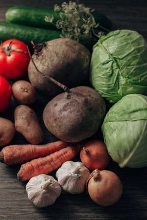 Fresh and Bright Vegetables Lie on the Kitchen Table