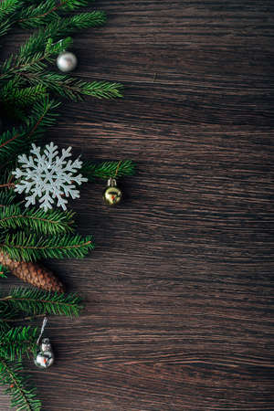 Christmas Tree Branches and Snowflakes on a Brown Background with Copy Space Zdjęcie Seryjne