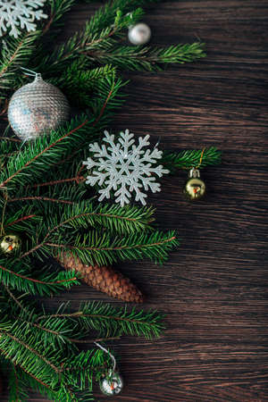Christmas Tree Branches and Snowflakes on a Brown Background with CopySpace Zdjęcie Seryjne