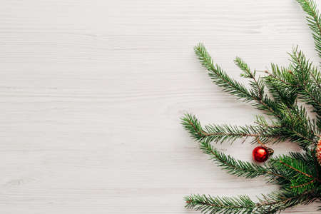 Christmas Composition on a White Wooden Table with Copy Space