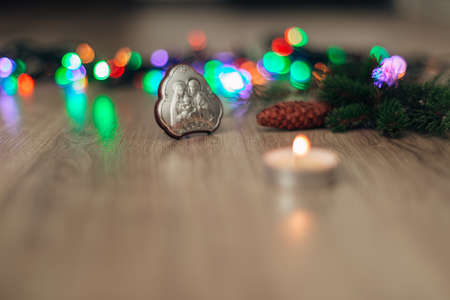 Christmas Composition of Church Icon on a Wooden Background With Multicolored Lights Zdjęcie Seryjne