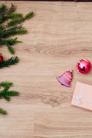 Christmas Tree Branches and on a Wooden Background with Copy Space Stock Photo