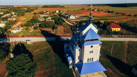 Beautiful autumnal rural landscape with a church in the foreground. Aerial view.