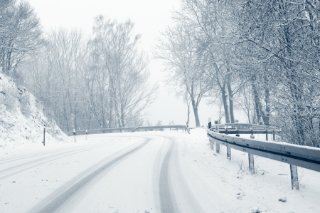 sudden: Snowy curvy country road - Sudden and heavy snowfall on a country road  Stock Photo