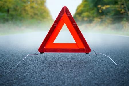 warning triangle: Caution fog - Warning triangle on a foggy road