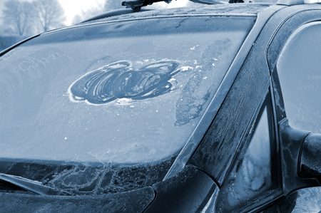 Ice over windshield - winter driving - careless ice removal Stock Photo - 23208621