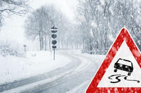 rail roads: Snowy curvy road with traffic sign