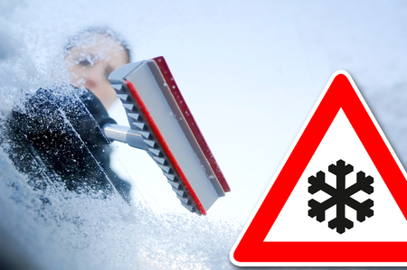 scrape: winter driving - Woman scraping ice from a windshield