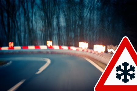 guardrail: caution, curvy road at night - Caution - driving on a curvy country road