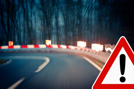 sharp curve: caution, curvy road at night - Caution - driving on a curvy country road