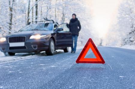 warning triangle: winter driving - car breakdown