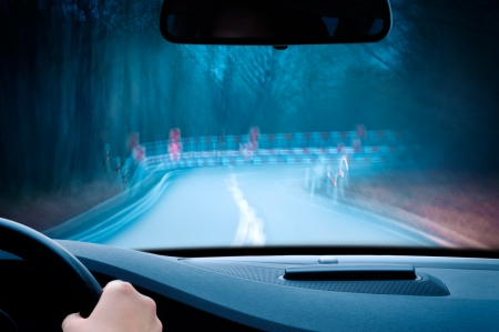 guardrail: night driving - caution, driving on a curvy country road