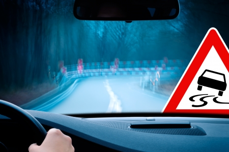 sharp curve: night driving - caution - driving on a curvy country road  Stock Photo