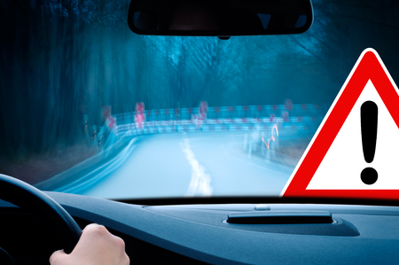 tunnel vision: night driving - caution - driving on a curvy country road  Stock Photo