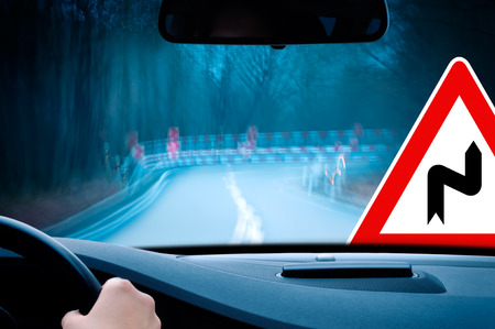 guardrail: night driving - caution - driving on a curvy country road  Stock Photo