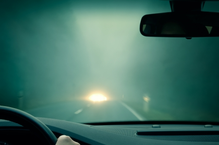 bad weather driving - foggy hazy country road - oncoming traffic Standard-Bild