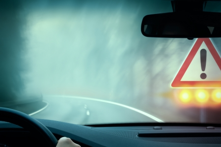 bad weather driving - country road - caution fog Stock Photo