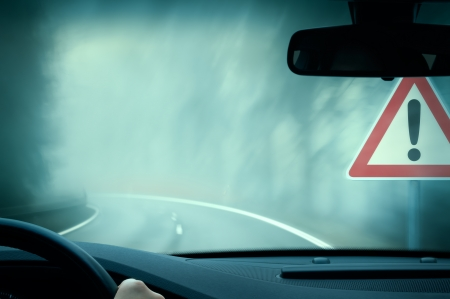 bad weather driving - country road - caution fog 스톡 콘텐츠