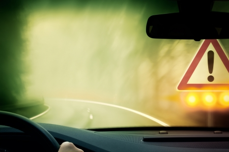 bad weather: bad weather driving - country road - caution fog Stock Photo