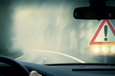 bad weather driving - country road - caution fog Foto de archivo