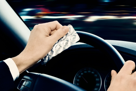 street drug: dangerous driving - Caution  Driving under the influence of medications and or alcohol can be dangerous  Stock Photo